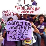 Young people march for the RH Bill, and for a safe and healthy workplace.