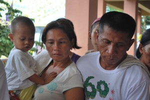 mother, father and child waiting for their turn - consultation with a pediatrician