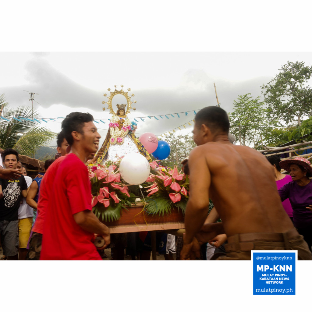 The people still hope that their patron saint will help them resolve the problem that they're facing. In this image, people are dancing with their local version of karakol, a kind of parade performed to appease the patron. | Photo by Juan Sinag Cano/MP-KNN