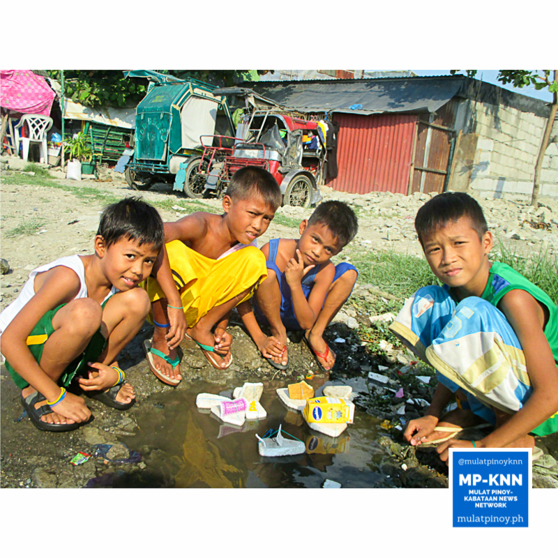 Boys busy playing with their DIY boat toys. | Photo by Joshua Principio/MP-KNN
